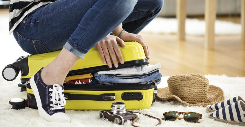 Koffer inpakken: Zo bespaar je ruimte! | Verzekeruzelf